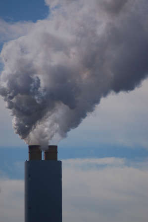 Industrial facility spewing smoke pollition into the air Stock Photo - 15216789