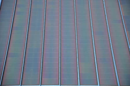Bank of modern square style solar panels photo
