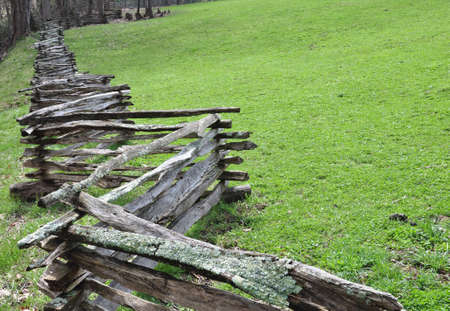 Rustic home made split rail fence in the mountains of North Carolina photo
