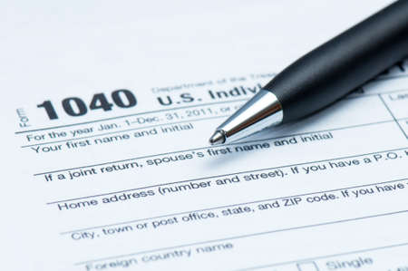 American tax form and closeup of executive style pen