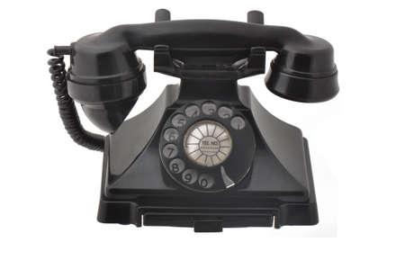 Antieke roterende telefoon geà ¯ soleerd op een witte achtergrond Stockfoto