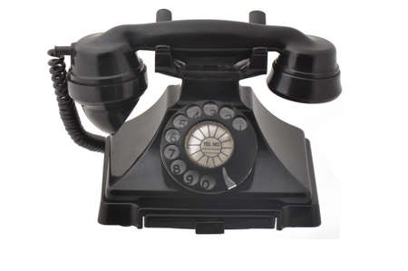 Antique rotary phone isolated on a white background