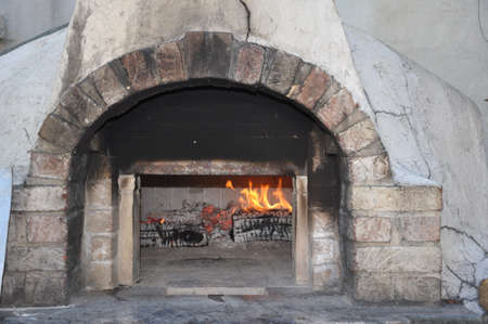 wood fired brick bread and pizza oven warming for baking
