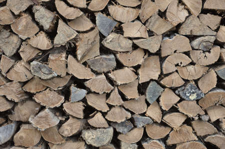 woodpile: Split and stacked firewood winter readiness background Stock Photo