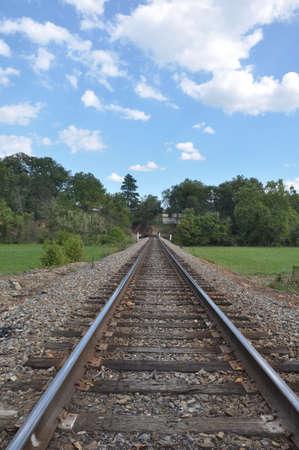 cutting through: Train tracks cutting through the mountains of North Carolina near Asheville on a sunny day.