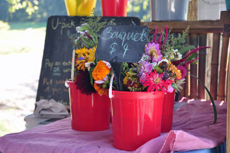 Bouquets of flowers being sold at a roadside stand in Asheville, North Carolina