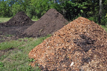Piles of mulch and manure at a farm in Asheville, North Carolina