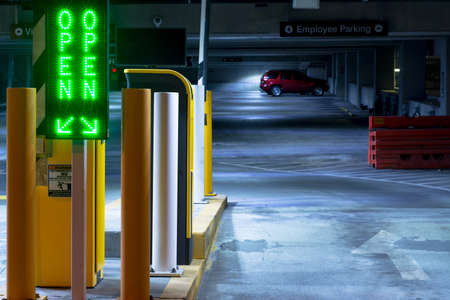 Night photo of a parking lot entrance in Raleigh, North Carolina