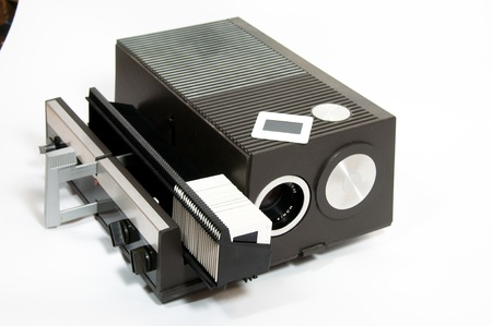 An old-fashioned slide projector is shown with a partially filled slide magazine  Banco de Imagens