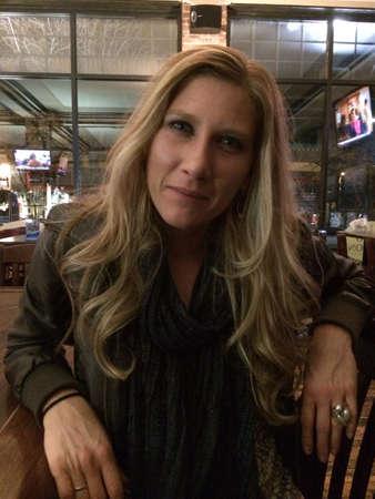 Pretty blonde woman in bar