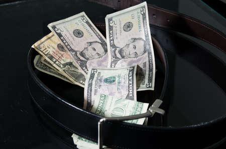 A belt cinching paper money Stock Photo