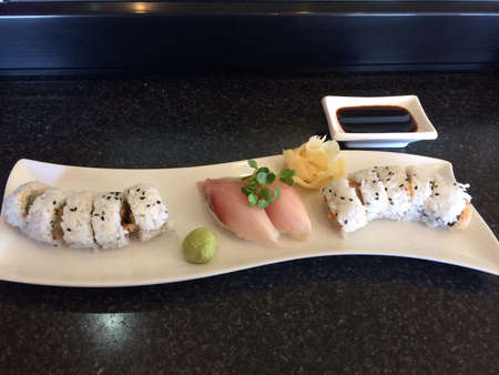 saki: Delicious spicy scallop roll sushi with hamachi  yellow tail nigiri.