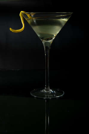 twist: vodka or gin martini with a lemon twist   Stock Photo