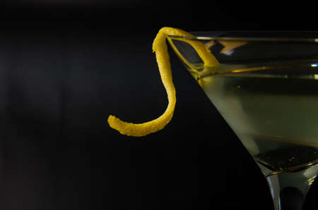 vermouth: close up of a lemon twist on a martini Stock Photo