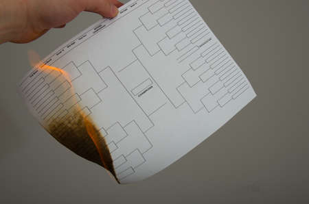 A loser college tournament bracket goes up in flames