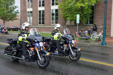 70 s: COEUR D ALENE 6-13-2014  Car d  Alene 2014  Coeur d  alene bike cops open the parade   Editorial