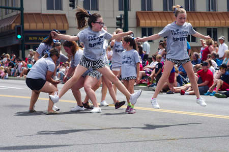 COEUR D ALENE, IDAHO 6-4-2014  4th of July Parade in downtown Coeur d  Alene; cheer girls do stunts