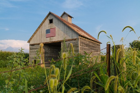 Old rustic barn in the Midwest with painted American flag.  LaSalle, Illinois, USA