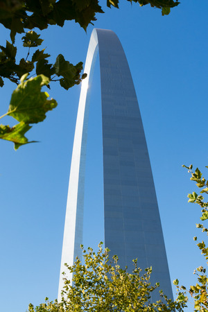 The Gateway Arch through the leaf covered trees.  St. Louis, Missouri, USA
