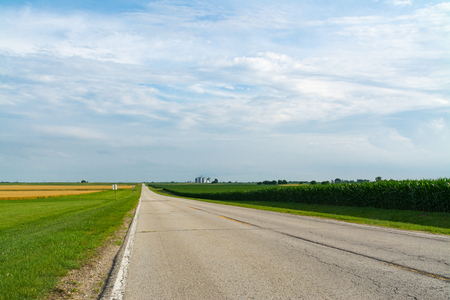 Rural two lane highway through the farmland.  LaSalle County, Illinois, USA
