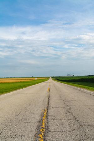 Rural two lane highway through the farmland.  LaSalle County, Illinois, USA