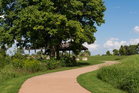 Curved concrete path through the prairie.  Channahon State Park, Illinois, USA.