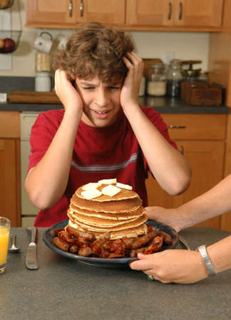 boy shocked by enormous breakfast photo