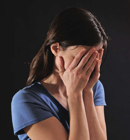 woman crying, covering face