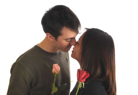 Loving couple kissing, with roses photo