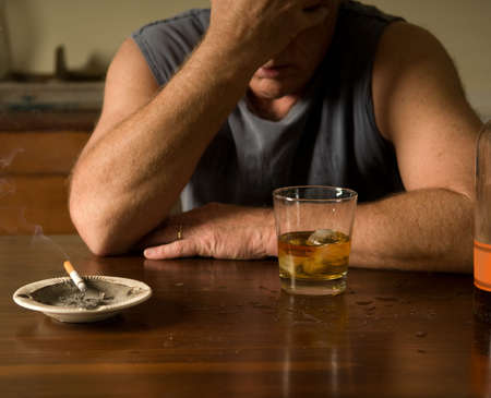 man smoking: lonely night Stock Photo