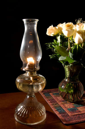 close up chimney: oil lamp with roses