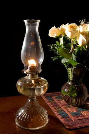 olielamp met rozen Stockfoto