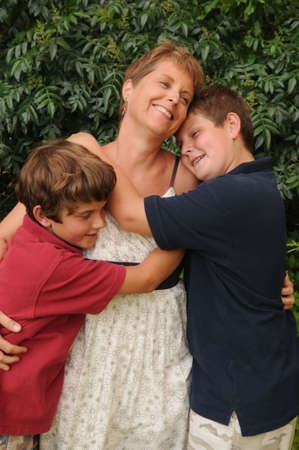 single mom holds sons close