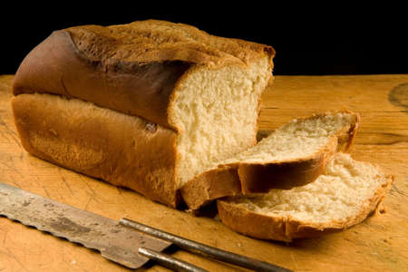 frshly baked loaf of white bread, with antique breaf knife Stock Photo - 4574006