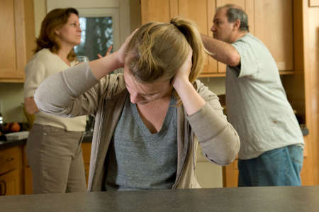 Daughter covers ears while parents fight Stock Photo - 4564820
