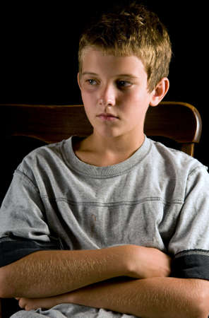 youngsters: lonely boy, seated portrait