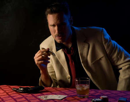 Gangstergambler with gun during poker game - he has a full house photo