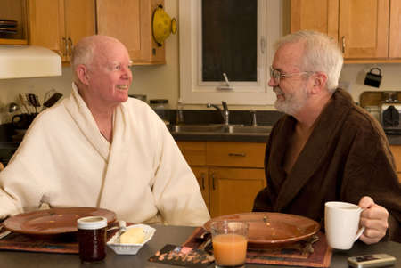 Mature married gay couple having breakfast photo