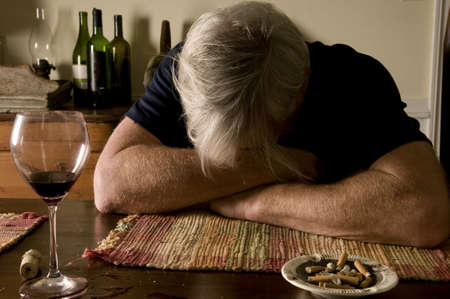 old desk: Overindulgence - wine and cigarettes