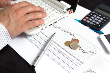 foreign exchange: Coins lying on the desk. Conception of investing in the foreign exchange market.