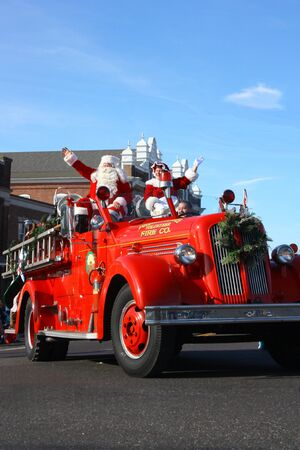 antique fire truck: Santa in Vintage Firetruck