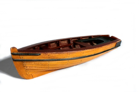 row: Wooden Toy Boat Stock Photo