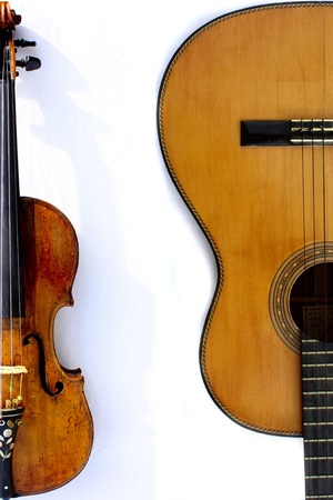 fiddles: Violin and guitar against a white background Stock Photo
