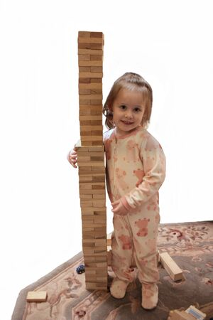 Toddler With Wooden Block Tower