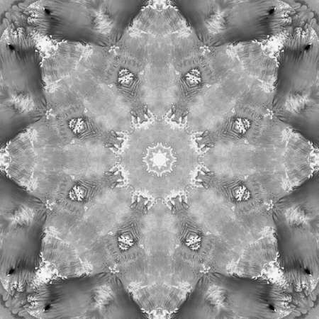 Black and White Grayscale Monochrome Mandala with art handmade texture. Kaleidoscopic sacred geometry element. Alchemy, religion, philosophy, astrology and spirituality themes. Universal background.