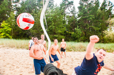 Jurmala, Latvia - August 20, 2011: Volleyball ball gets into the net. Beach volleyball game during the Baltic summer jewish seminar in Jurmala, Latvia.