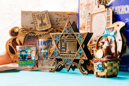 Vilnius, Lithuania: On this studio shot that was made in Vilnius, Lithuania you can see almost all examples of the Jewish traditional attributes, souvenirs, mascots in one collection. Stock Photo