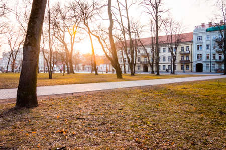 Vilnius, Lithuania: Sunset light through the early spring trees in cozy Old Town park on T. Vrublevskio street in Vilnius Lithuania.