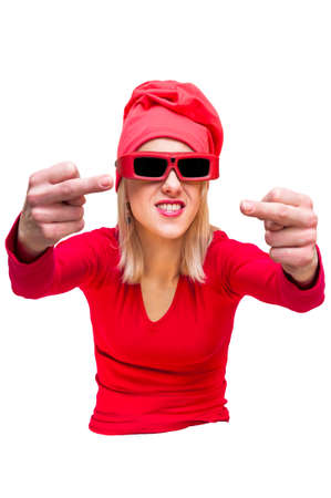 Red hat shirt and sunglasses blonde woman showing obscene gesture middle fingers with two hands. Cut out on white background.