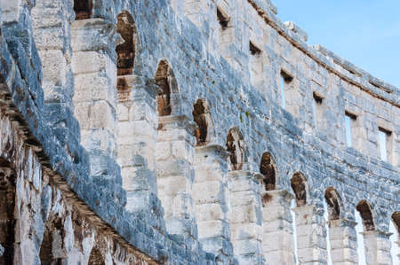 Pula, Croatia: Stone arc columns rows in Pula Arena. The most famous and important monument in Pula, popularly called the Arena of Pula, which was once the site of gladiator fights